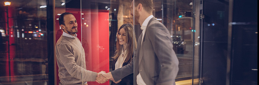 two retailers shaking hands with candidate