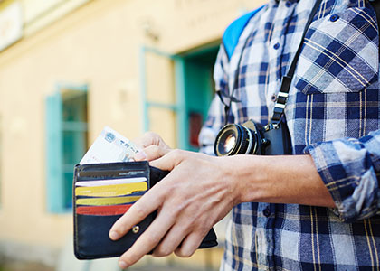 tourist opening wallet
