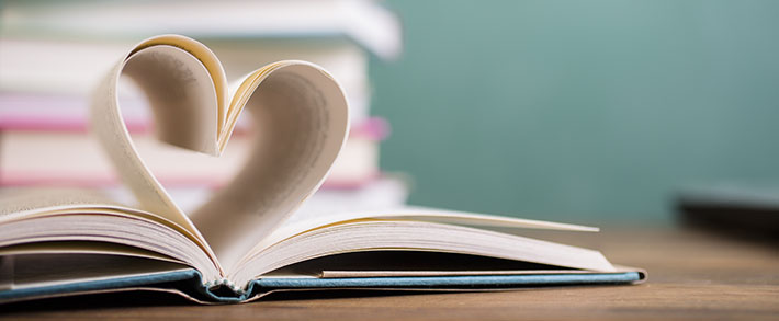 Heart shape in open school book pages.