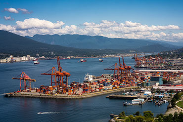 West Coast port lockout ended by tentative settlement